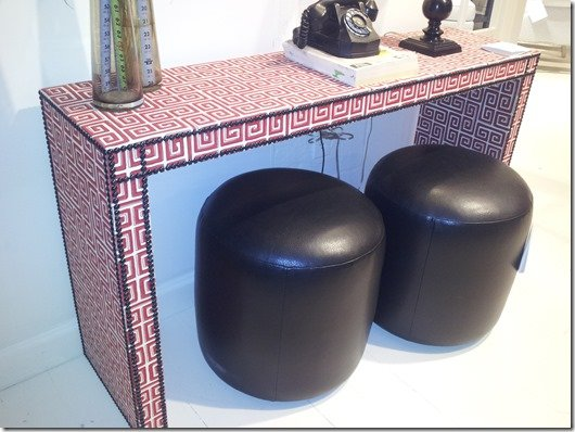 upholstered console in greek key pattern