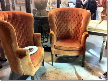 Vintage orange velvet wing chairs